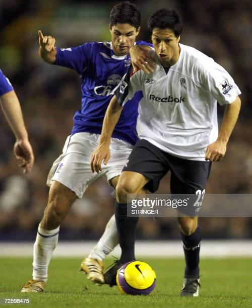 Everton's Mikel Arteta vies with Bolton's Idan Tal during their English Premiership football match at Goodison Park, Merseyside, north-west England,...