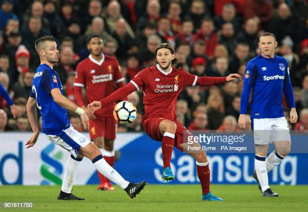 Everton's Morgan Schneiderlin and Liverpool's Adam Lallana battle for the ball during the FA Cup third round match at Anfield Liverpool