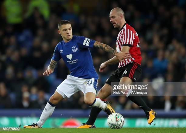 Everton's Muhamed Besic and Sunderland's Darron Gibson battle for the ball during the Carabao Cup Third Round match at Goodison Park Liverpool