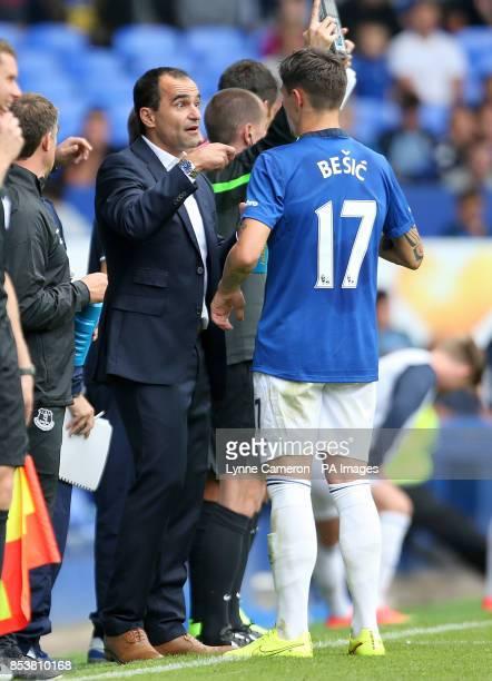 Everton's Muhamed Besic speaks to manager Roberto Martinez on the touchline