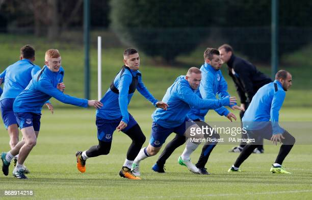 Everton's Muhamed Besic Wayne Rooney and Everton's Morgan Schneiderlin during the training session at Finch Farm Liverpool