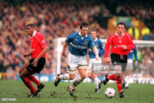 Everton's Nick Barmby cuts between Nottingham Forest's Carlton Palmer and Alan Rogers