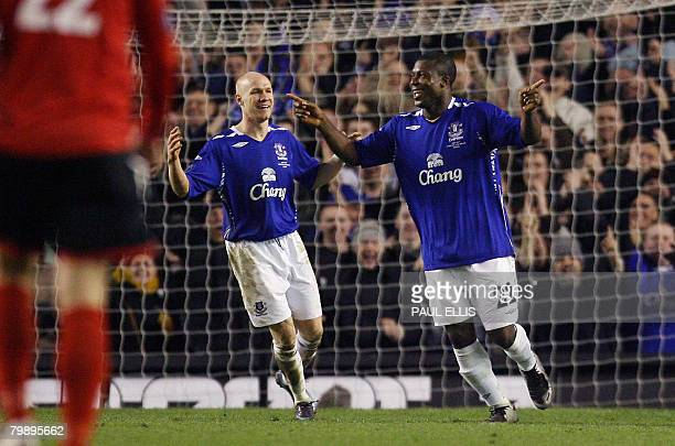 Everton's Nigerian forward Yakubu celebrates his second goal against SK Brann with Everton's English forward Andrew Johnson during their UEFA Cup...