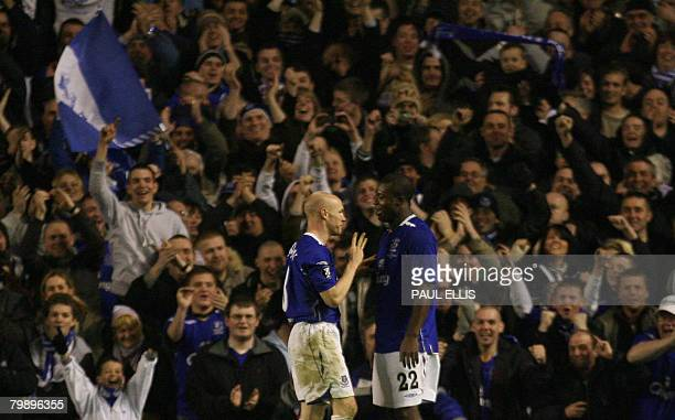 Everton's Nigerian forward Yakubu celebrates his third goal against SK Brann with Everton's English forward Andrew Johnson during their UEFA Cup...