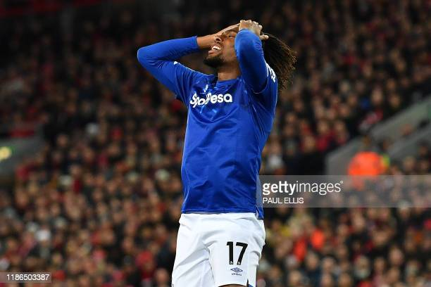 Everton's Nigerian midfielder Alex Iwobi reacts after failing to score during the English Premier League football match between Liverpool and Everton...