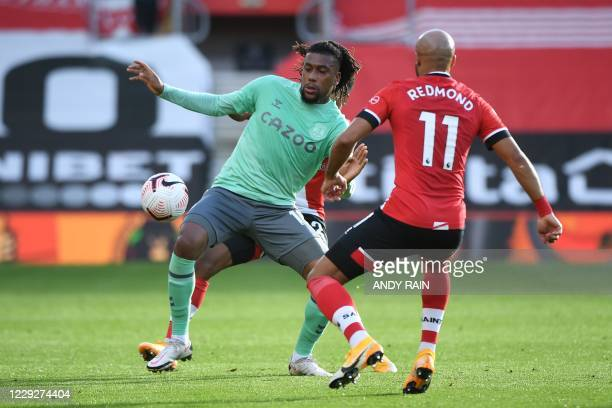 Everton's Nigerian midfielder Alex Iwobi vies for the ball with Southampton's English midfielder Nathan Redmond during the English Premier League...