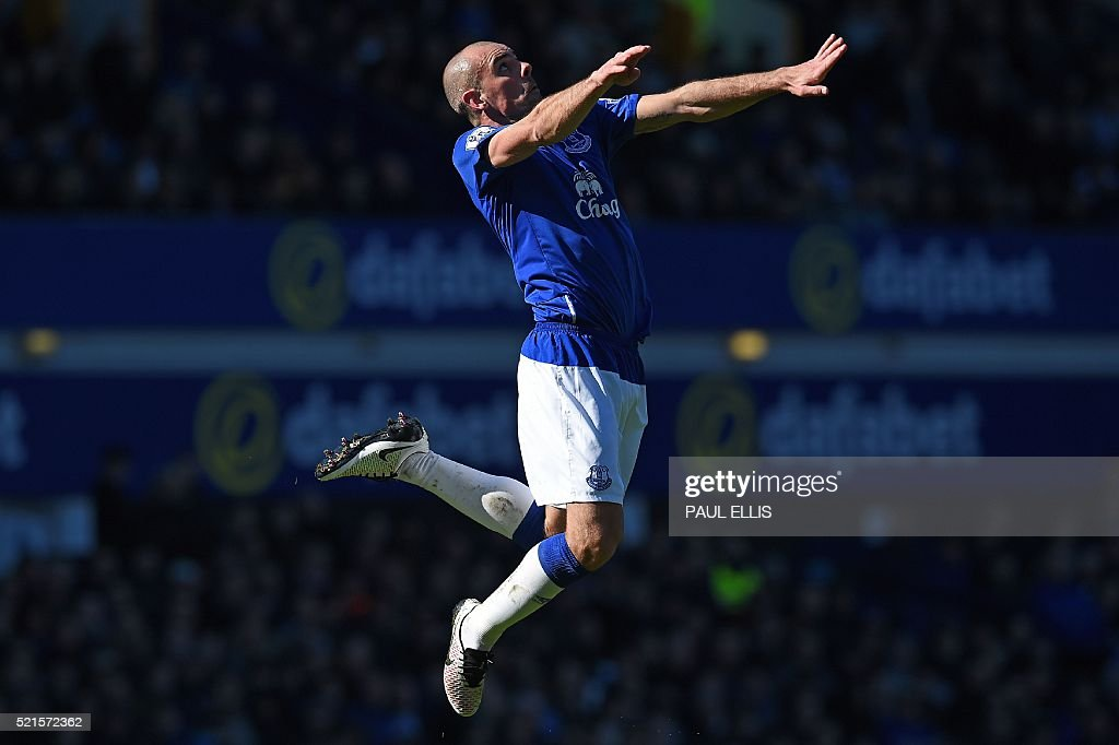 Everton's Northern Irish midfielder Darron Gibson jumps for the ball during the English Premier League football match between Everton and Southampton at Goodison Park in Liverpool, north west England on April 16, 2016. The game finished 1-1. / AFP / Paul ELLIS / RESTRICTED TO EDITORIAL USE. No use with unauthorized audio, video, data, fixture lists, club/league logos or 'live' services. Online in-match use limited to 75 images, no video emulation. No use in betting, games or single club/league/player publications. /