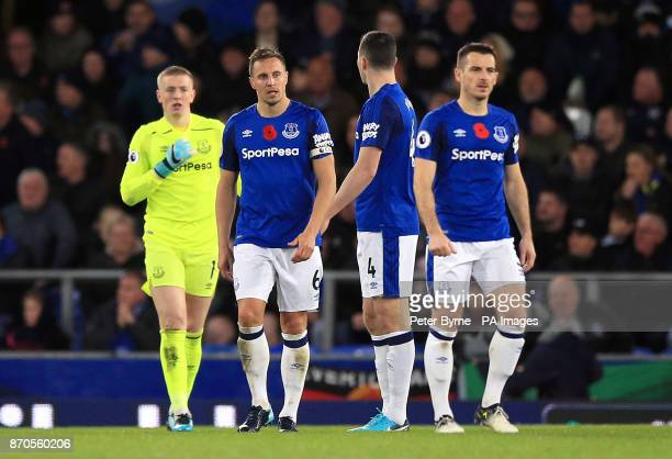 Everton's Phil Jagielka appears dejected after Watford's Richarlison scores his side's first goal of the game during the Premier League match at...