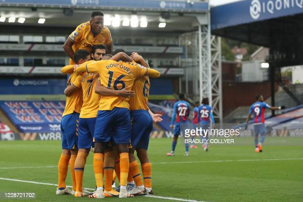 Everton's players celebrate after Everton's Brazilian striker Richarlison scores their second goal from the penalty spot during the English Premier...