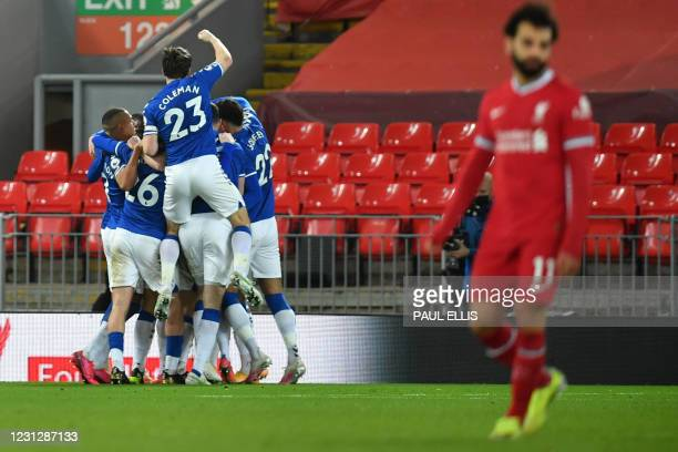 Everton's players celebrate their second goal during the English Premier League football match between Liverpool and Everton at Anfield in Liverpool,...