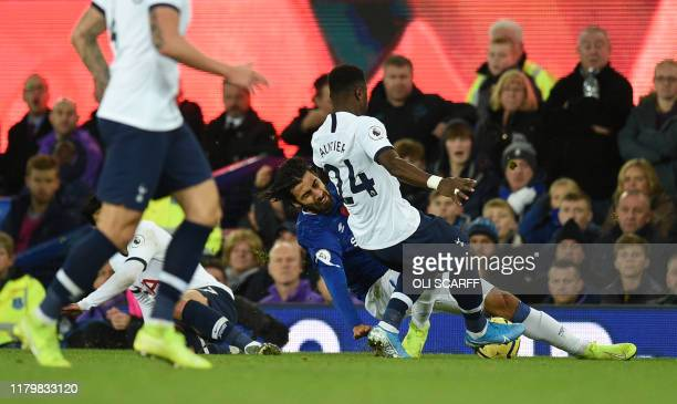 TOPSHOT Everton's Portuguese midfielder André Gomes is brought down after being clipped by Tottenham Hotspur's South Korean striker Son HeungMin and...