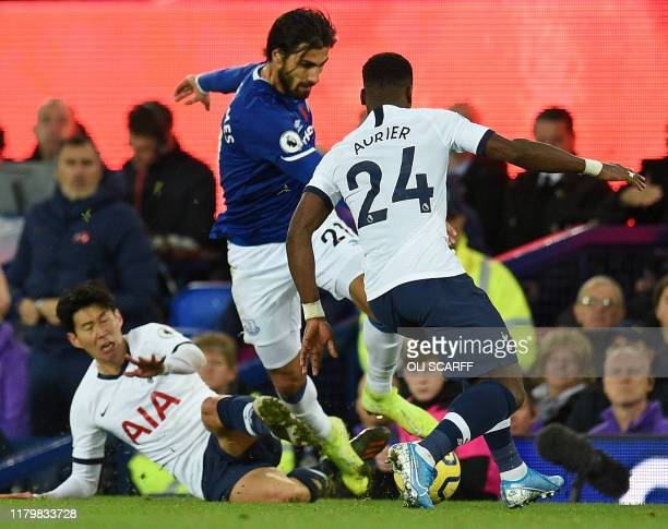 Everton's Portuguese midfielder André Gomes is brought down in a challenge by Tottenham Hotspur's South Korean striker Son Heung-Min as Tottenham...