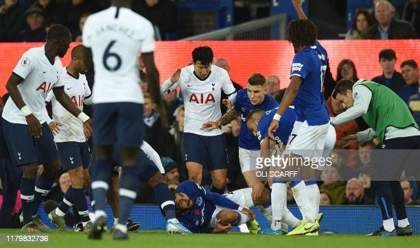 TOPSHOT Everton's Portuguese midfielder André Gomes reacts to an injury to his leg during the English Premier League football match between Everton...