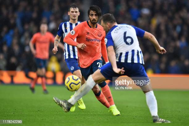 Everton's Portuguese midfielder André Gomes takes on Brighton's English midfielder Dale Stephens during the English Premier League football match...