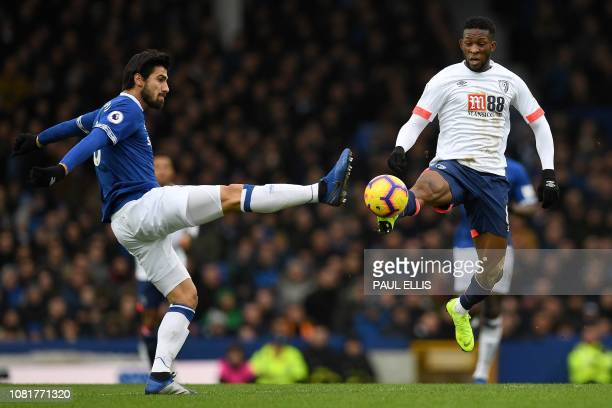 Everton's Portuguese midfielder André Gomes vies with Bournemouth's Colombian midfielder Jefferson Lerma during the English Premier League football...