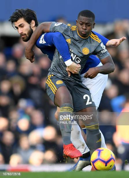Everton's Portuguese midfielder André Gomes vies with Leicester City's French midfielder Nampalys Mendy during the English Premier League football...