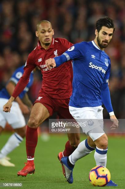 Everton's Portuguese midfielder André Gomes vies with Liverpool's Brazilian midfielder Fabinho during the English Premier League football match...