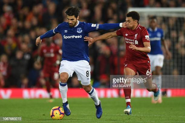 Everton's Portuguese midfielder André Gomes vies with Liverpool's English defender Trent Alexander-Arnold during the English Premier League football...