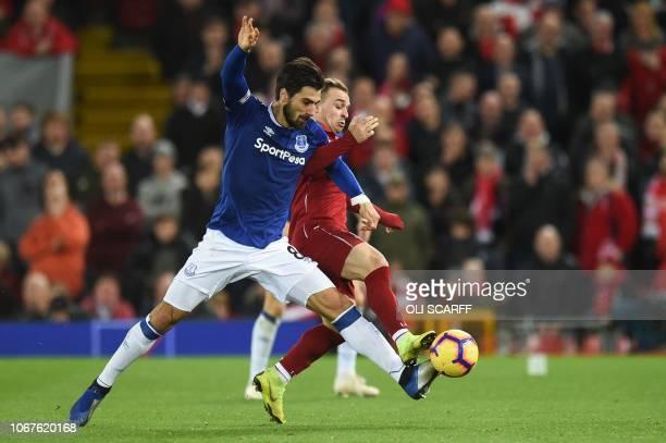 Everton's Portuguese midfielder André Gomes vies with Liverpool's Swiss midfielder Xherdan Shaqiri during the English Premier League football match...