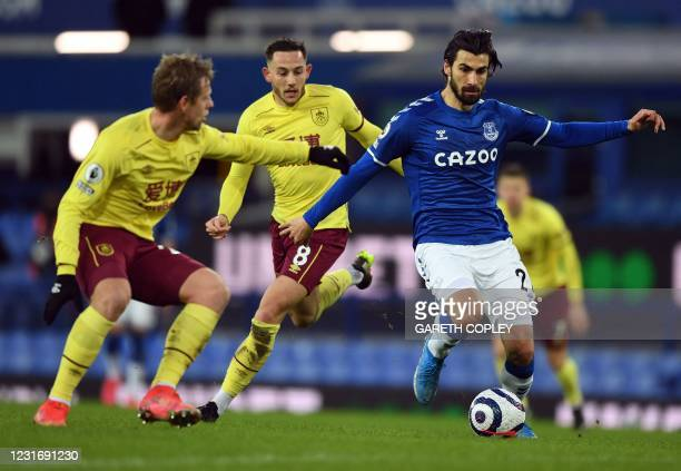 Everton's Portuguese midfielder Andre Gomes controls the ball during the English Premier League football match between Everton and Burnley at...