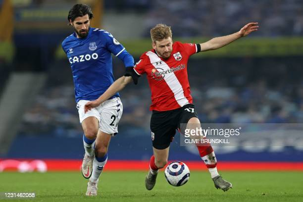 Everton's Portuguese midfielder Andre Gomes vies with Southampton's Scottish midfielder Stuart Armstrong during the English Premier League football...