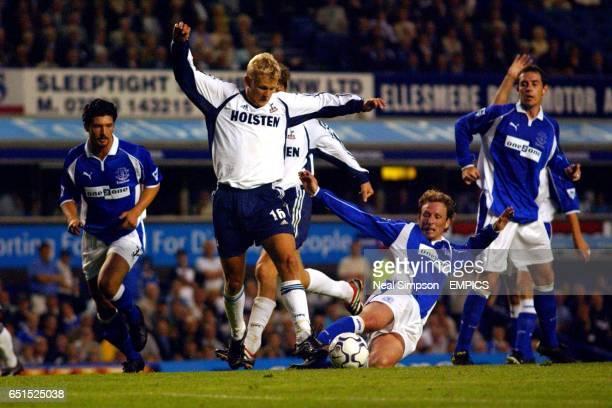 Everton's Scot Gemmill stretches in a vain attempt to tackle Tottenham Hotspur's Steffen Iversen