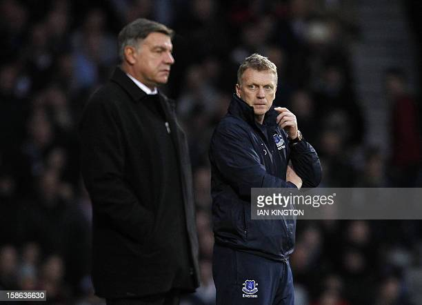 Everton's Scottish manager David Moyes looks towards West Ham United's English manager Sam Allardyce during the English Premier League football match...