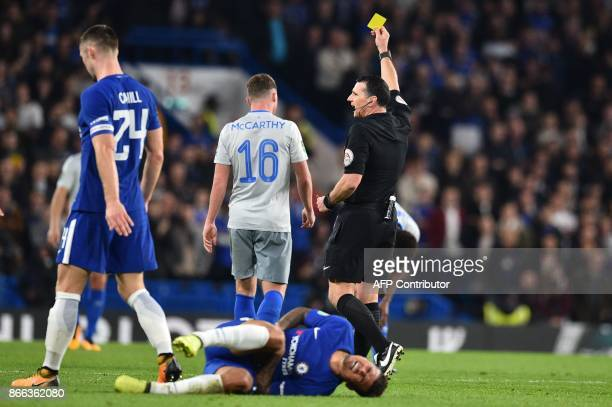 Everton's Scottishborn Irish midfielder James McCarthy is shown a yellow card during the English League Cup fourth round football match between...
