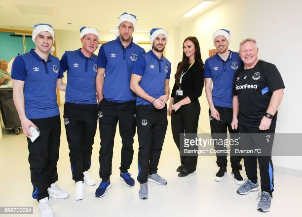 Everton's Seamus Coleman James McCarthy Maarten Stekelenburg Kevin Mirallas Davy Klassan and assistant manager Sammy Lee pose with a member of the...