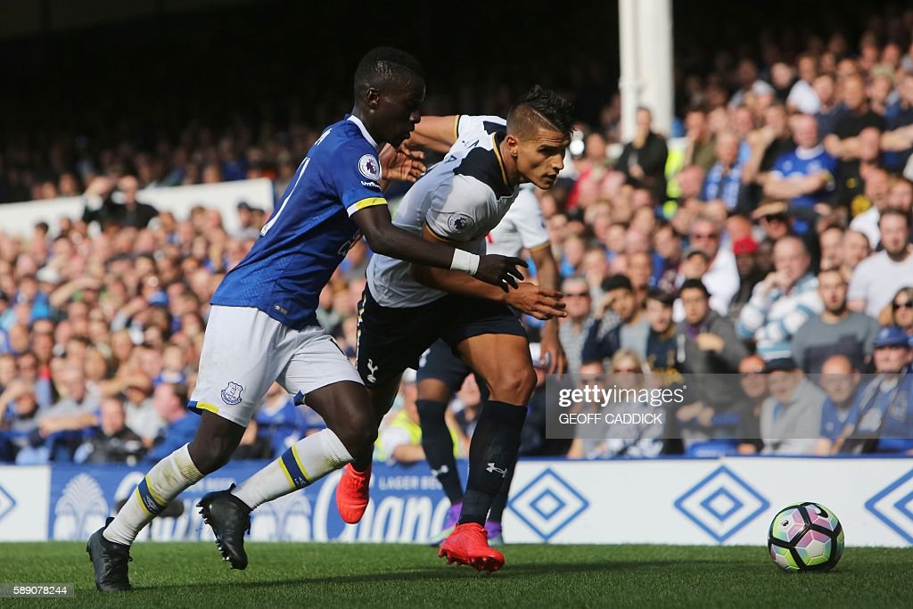 Everton's Senegalese midfielder Idrissa Gueye (L) tries to stop Tottenham Hotspur's Argentinian midfielder Erik Lamela (R) during the English Premier League football match between Everton and Tottenham Hotspur at Goodison Park in Liverpool, north west England on August 13, 2016. / AFP / GEOFF CADDICK / RESTRICTED TO EDITORIAL USE. No use with unauthorized audio, video, data, fixture lists, club/league logos or 'live' services. Online in-match use limited to 75 images, no video emulation. No use in betting, games or single club/league/player publications. /