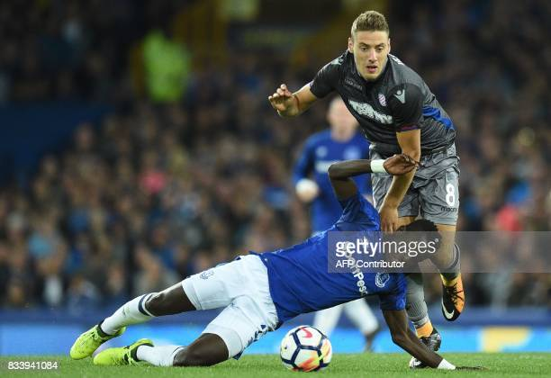 Everton's Senegalese midfielder Idrissa Gueye vies with Hajduk Split's Nikola Vlasic during the UEFA Europa League playoff round first leg football...