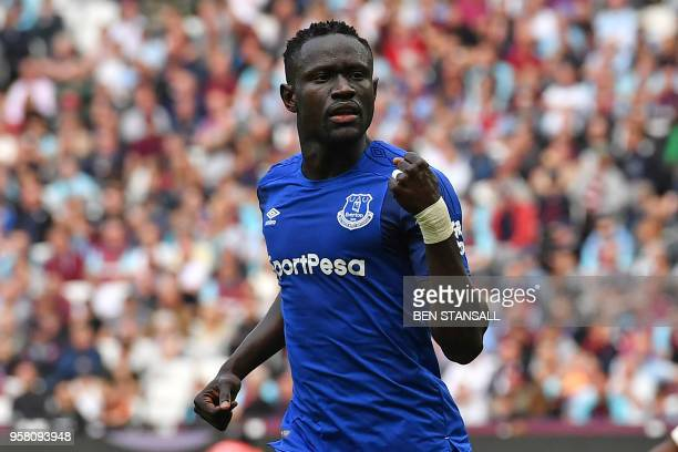 Everton's Senegalese striker Oumar Niasse celebrates after scoring their first goal during the English Premier League football match between West Ham...
