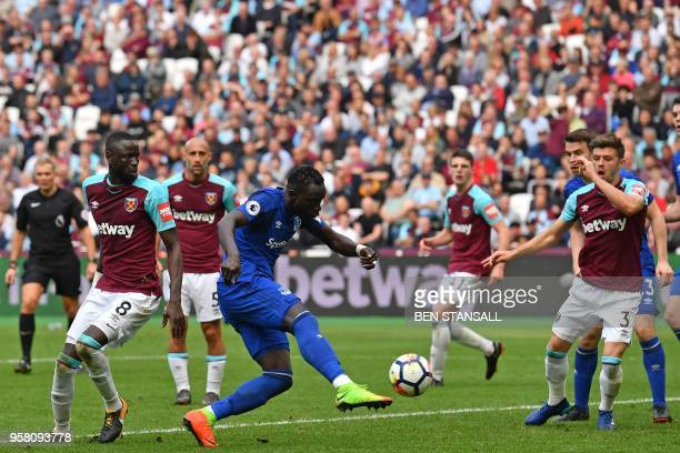 Everton's Senegalese striker Oumar Niasse shoots to score their first goal during the English Premier League football match between West Ham United...