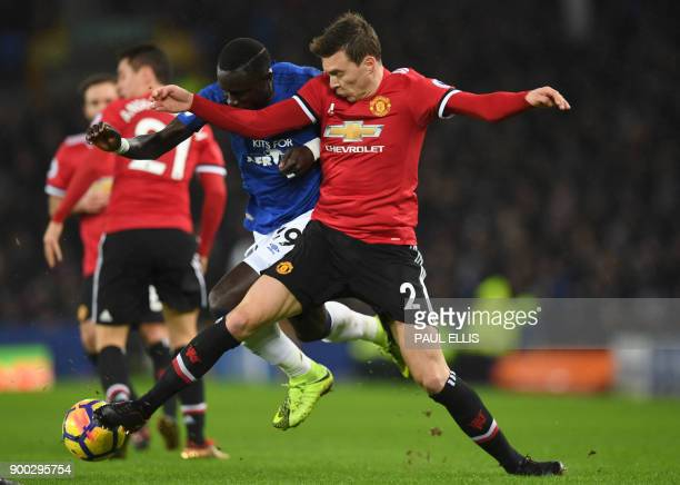 Everton's Senegalese striker Oumar Niasse vies with Manchester United's Swedish defender Victor Lindelof during the English Premier League football...