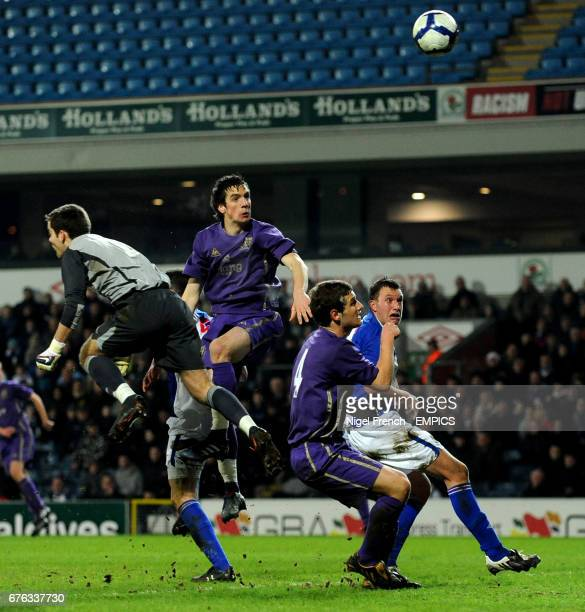 Everton's Shane Duffy heads in the first goal of the game for Everton