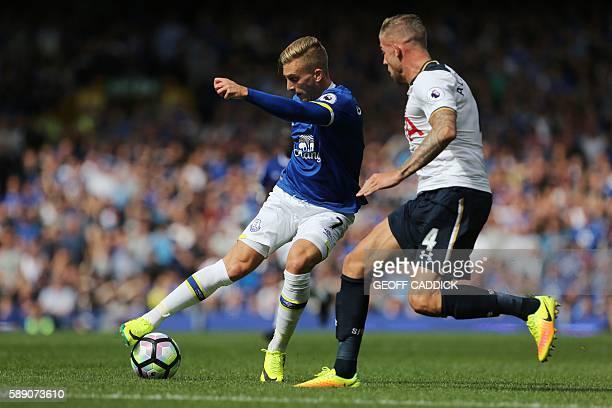 Everton's Spanish midfielder Gerard Deulofeu takes on Tottenham Hotspur's Belgian defender Toby Alderweireld during the English Premier League...