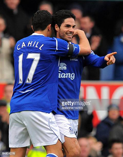 Everton's Spanish midfielder Mikel Arteta celebrates with Everton's Australian midfielder Tim Cahill after scoring a penalty during the FA cup fifth...