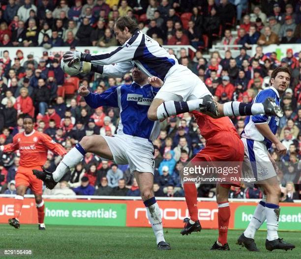 Everton's Steve Simonsen makes a good save as Middlesbrough's Szilard Nemeth makes a challenge during the Middlesbrough v Everton AXAsponsored FA Cup...