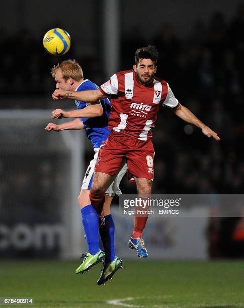 Everton's Steven Naismith and Cheltenham Town's Sam Deering battle for the ball