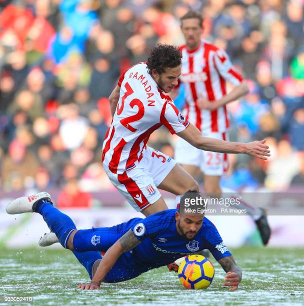 Everton's Theo Walcott and Stoke City's Ramadan Sobhi battle for the ball during the Premier League match at the bet365 Stadium Stoke