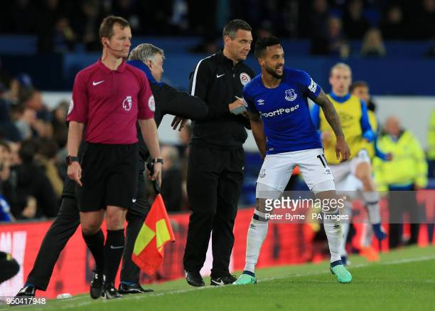 Everton's Theo Walcott gets instructions from Everton manager Sam Allardyce during the Premier League match at Goodison Park Liverpool