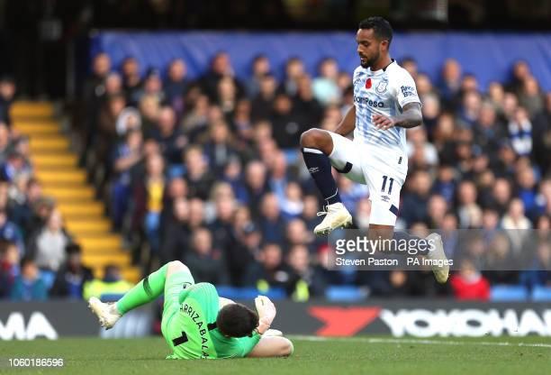 Everton's Theo Walcott in action against Chelsea goalkeeper Kepa Arrizabalaga during the Premier League match at Stamford Bridge London