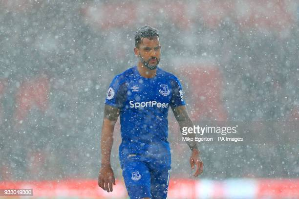 Everton's Theo Walcott in the snow during the Premier League match at the bet365 Stadium Stoke