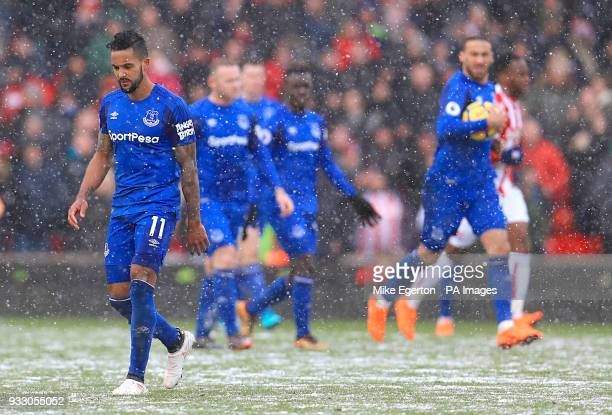 Everton's Theo Walcott shows his dejection as Stoke City equalise during the Premier League match at the bet365 Stadium Stoke