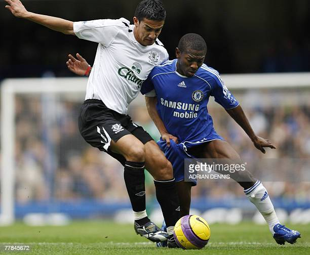 Everton's Tim Cahill fights for the ball with Chelsea's Shaun WrightPhillips during their Premiership football match at Stamford Bridge in London 11...