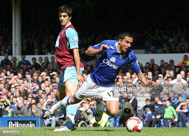 Everton's Tim Cahill is fouled by James Tomkins leading to the West Ham United defender conceding a penalty and being sent off