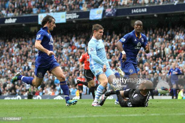 Everton's Tim Howard dives at teh feet of Manchester City's James Milner during the Premier League match between Manchester City and Everton at the...