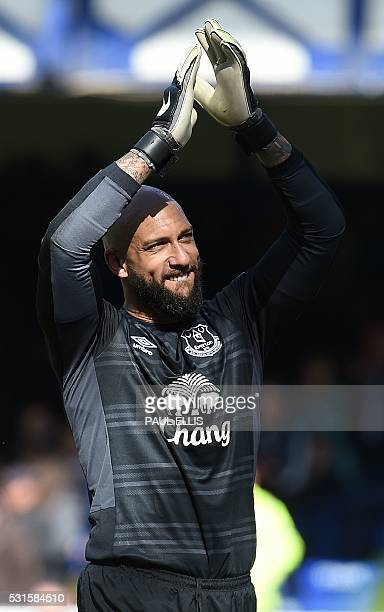 Everton's US goalkeeper Tim Howard applauds the fans following the English Premier League football match between Everton and Norwich City at Goodison...