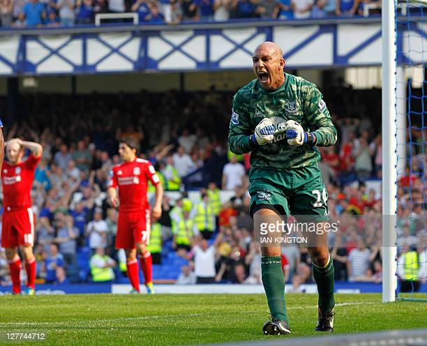 Everton's US goalkeeper Tim Howard reacts after saving a penalty by Liverpool's Dutch striker Dirk Kuyt during the English Premier League football...
