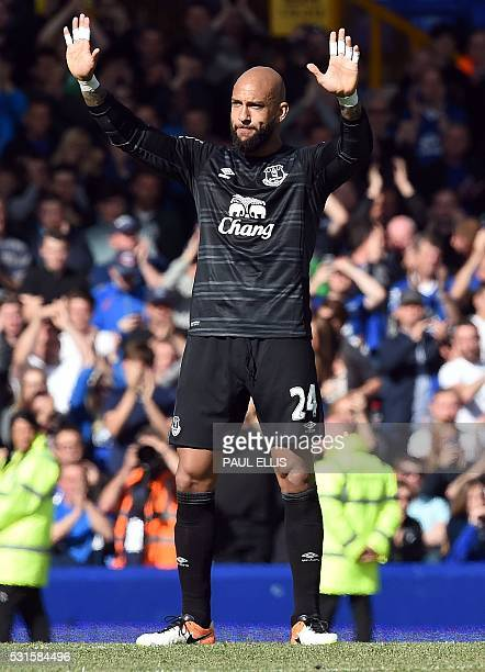 Everton's US goalkeeper Tim Howard waves to the crowds following the English Premier League football match between Everton and Norwich City at...